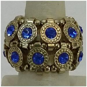 Multi Stone Ring. Goldentone band. Stretchy.
